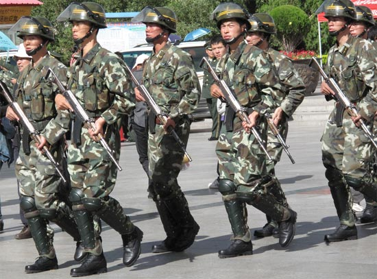 Chinese soldiers dealing with Tibetan protest